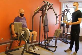 Masked resident works out with an HSL trainer.