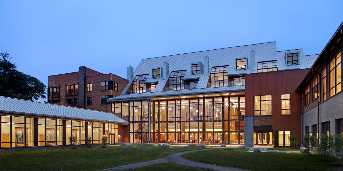 The Shapiro Community Center at NewBridge on the Charles, pictured at dusk, offers many amenities open to all NewBridge residents.