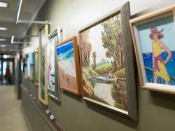 Between the lobby and library of Orchard Cove lies a rotating gallery of resident art.