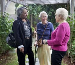 Three CCB residents enjoy a moment in the outside garden.