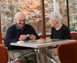 Two CCB residents enjoy a game of Trivial Pursuit