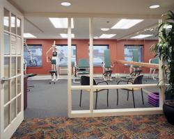 The entrance to the Center Communities of Brookline fitness room, lined with fitness equipment.
