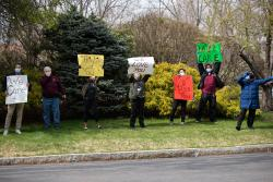 HSL staff stand outside of Simon C. Fireman Community holding signs of love and support