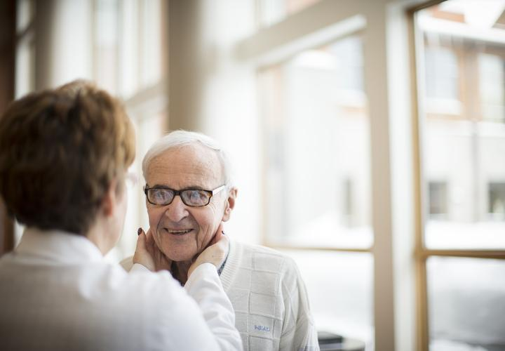 An older man is seen by a Harvard Medical School-affiliated health care provider as part of the on-site health care services offered at NewBridge on the Charles.