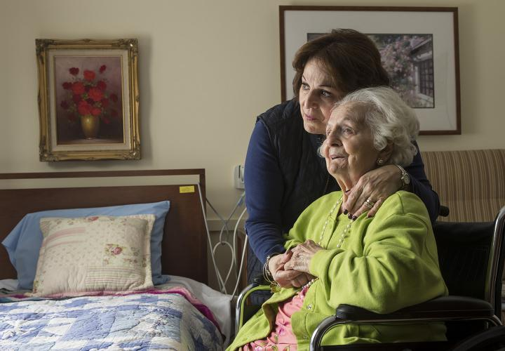 A long-term chronic care patient of Hebrew Rehabilitation Center at NewBridge on the Charles shares a hug with her adult daughter.