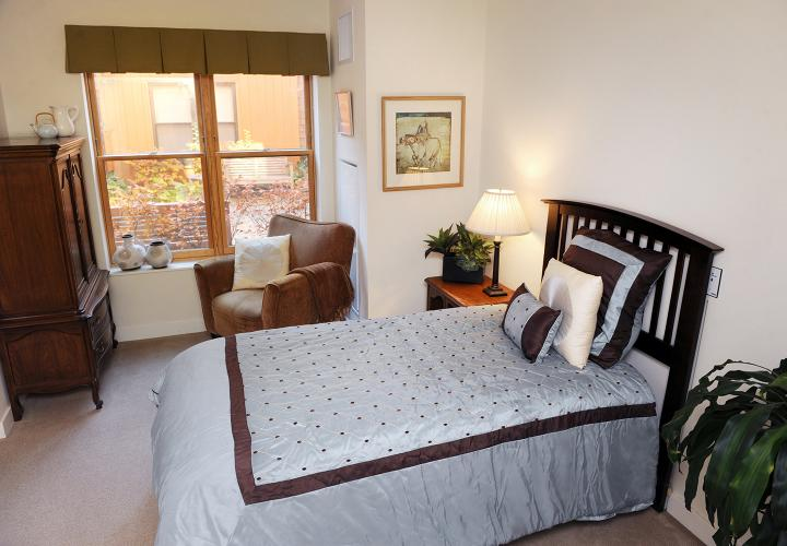 Sunny memory assisted living bedroom sample