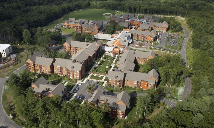 An aerial view shows the NewBridge on the Charles campus, including independent and assisted living residences, surrounded by beautiful green space.