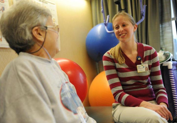 A patient meets with a therapist during a rehabilitation session with staff at Hebrew Rehabilitation Center.