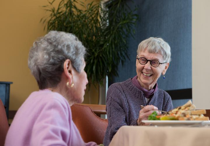 Two Center Communities of Brookline women eating and laughing together