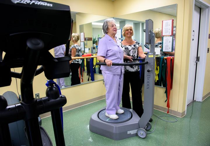 An older woman exercises at Hebrew Rehabilitation Center in Boston as part of our supervised Get Up & Go fitness program.