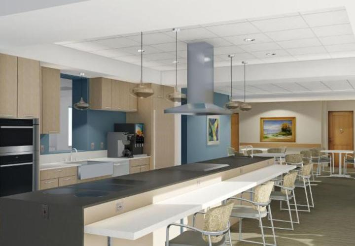 : The recently renovated kitchens in memory assisted living at NewBridge on the Charles feature an open plan, luxury finishes, and noise-absorbing design.